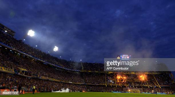 Boca Juniors supporters celebrate after their team defeats Union and wins Argentina's first division football championship at La Bombonera stadium in...
