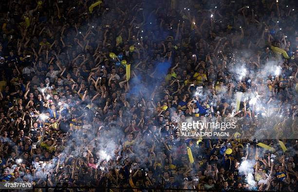 Boca Juniors supporters cheer for their team during their Copa Libertadores 2015 round before the quarterfinals second leg football match against...