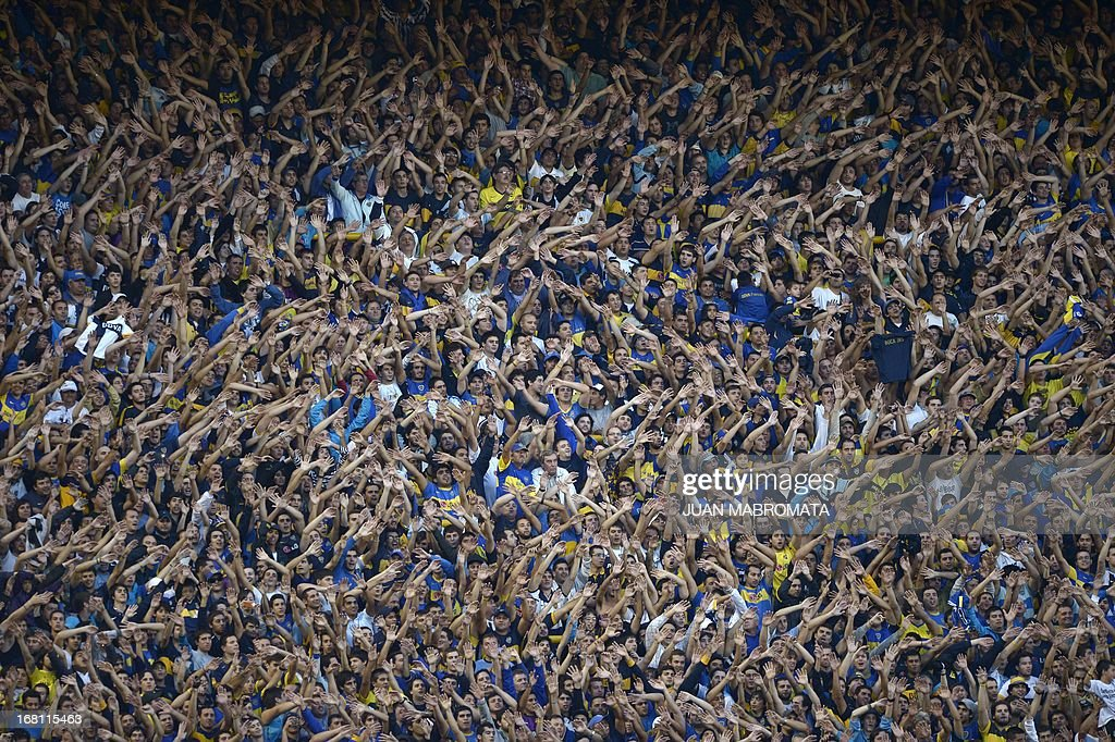 Boca Juniors' supporters cheer their teame during the Argentine first division football match against River Plate at 'La Bombonera' stadium in Buenos Aires, Argentina, on May 5, 2013. AFP PHOTO / Juan Mabromata