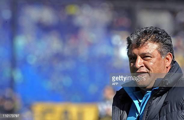 Boca Juniors' team coach Claudio Borghi gestures during their Argentina first division football match against Racing Club at La Bombonera stadium in...
