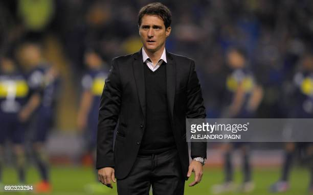 Boca Juniors' team coach Guillermo Barros Schelotto gestures during their Argentina first divsion football match against Independiente at La...