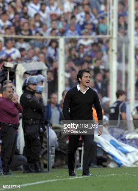 Boca Juniors' team coach Guillermo Barros Schelotto gestures during their Argentina First Division Superliga football match against Velez Sarsfield...