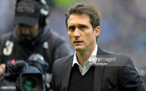 Boca Juniors' team coach Guillermo Barros Schelotto walks to the bench before the Argentina First Division Superliga football match against Chacarita...