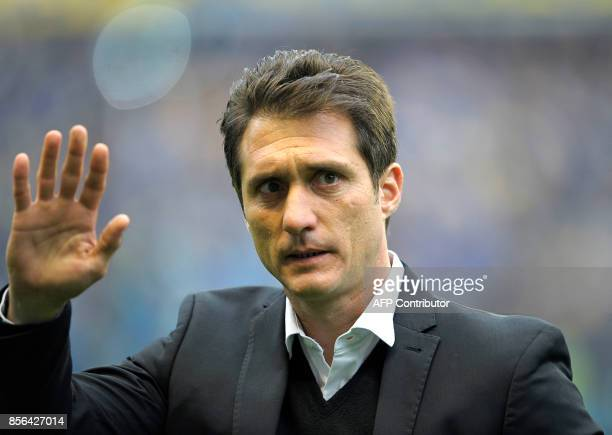 Boca Juniors' team coach Guillermo Barros Schelotto waves to supporters before the Argentina First Division Superliga football match against...