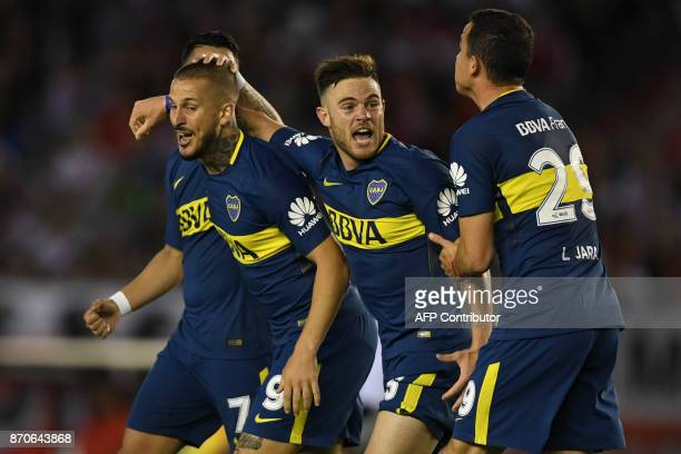 Boca Juniors' Uruguayan midfielder Nahitan Nandez celebrates with teammates after scoring during the Argentine derby match against River Plate in the...