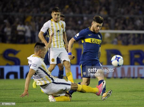 Boca Juniors' Uruguayan midfielder Nahitan Nandez vies for the ball with Rosario Central's Mauricio Martinez during their Argentina's Superliga first...