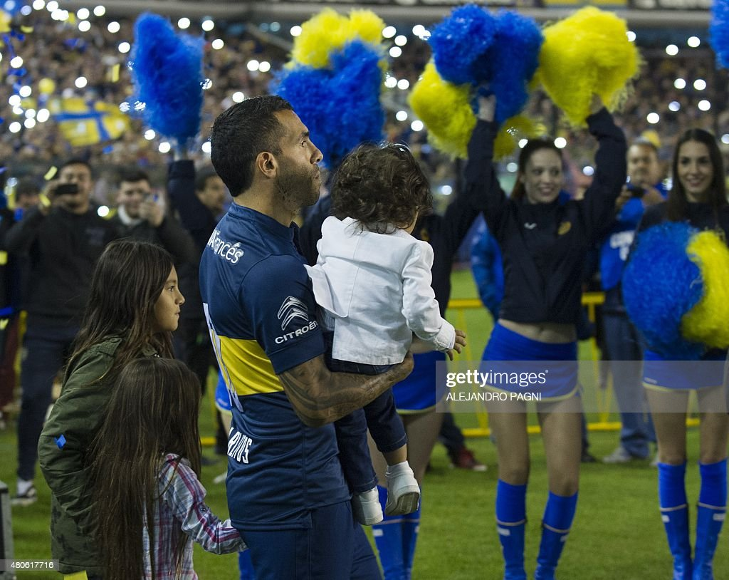 Boca Juniors's newly returned player Carlos Tevez and his two sisters enter the field during his official presentation at La Bombonera stadium in Buenos Aires,on July 13, 2015.