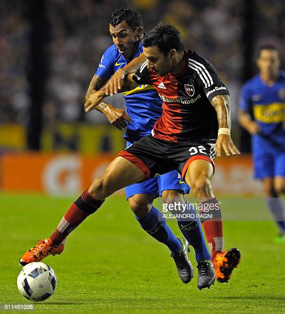 Boca's footballer Carlos Tevez and Newells' Ignacio Scocco vie for the ball during their Argentina First Division football match against Newells at...