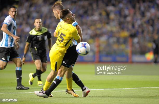 Boca's midfielder Nahitan Nandez is stopped with penalty by Racing's defender Miguel Angel Barbieri during their Argentina Superliga First Division...