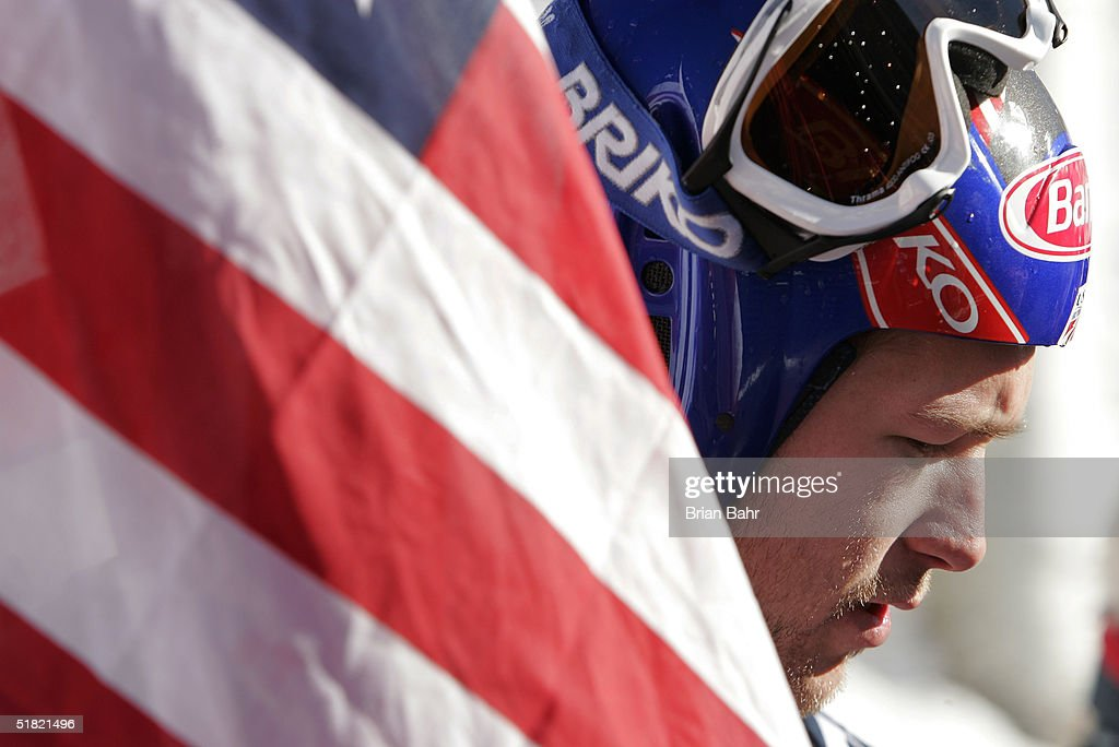 Bode Miller carries the American flag as he descends from the podium after taking first place in the men's World Cup Downhill on December 3, 2004 on the Birds of Prey course at Beaver Creek, Colorado. It is the first time the U.S. men have taken the top two spots in a world skiing speed event.