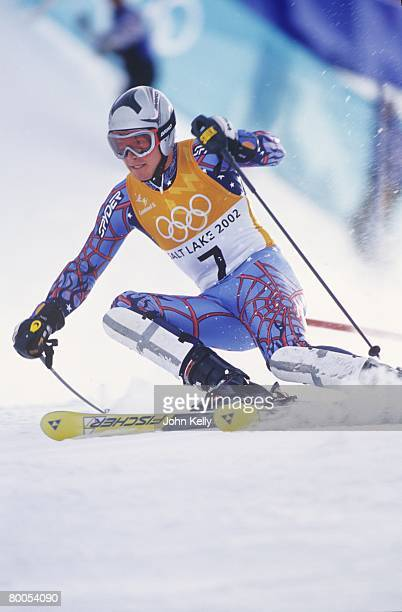 Bode Miller carves around a gate during the combinded slalom event during the 2002 Winter Olympics