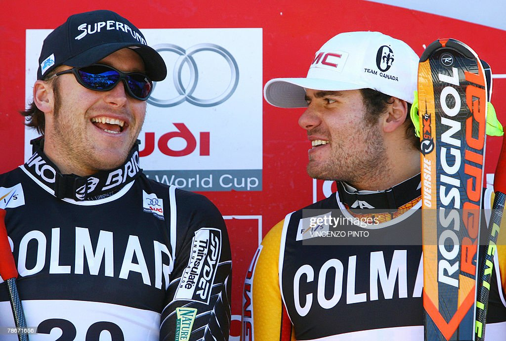 US Bode Miller (L) celebrates with Jan Hudec of Canada on the podium of the Men's FIS Alpine World Cup Downhill event in Bormio, 29 December 2007. American Bode Miller claimed his first World Cup victory of the season ahead of Austrian Andreas Buder and Jan Hudec of Canada.