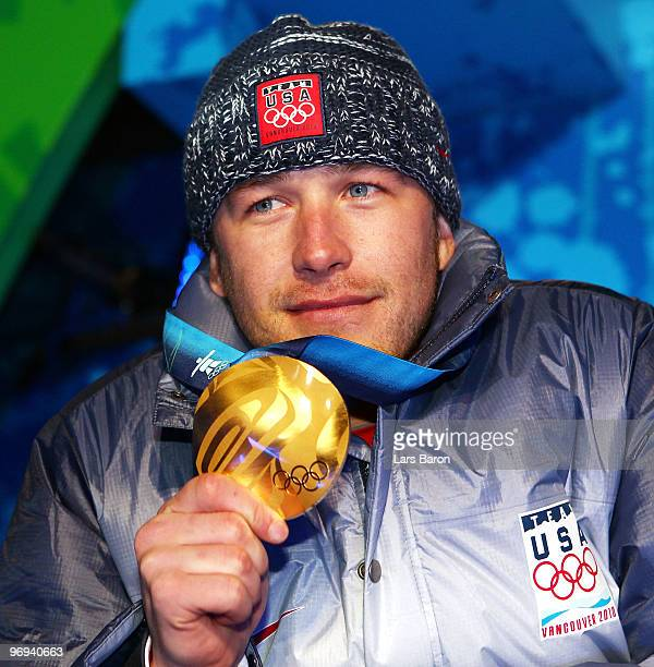 Bode Miller of the United States celebrates his Gold medal during the medal ceremony for the Men's Alpine Skiing Super Combined on day 10 of the...