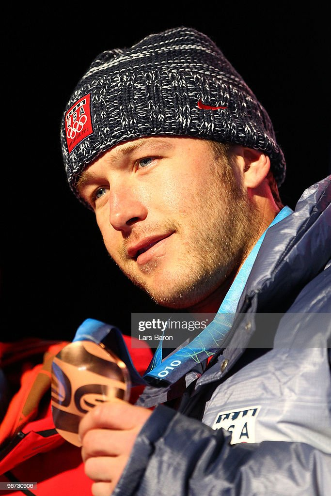 Bode Miller of the United States poses with the bronze at the medal ceremony for the Alpine skiing Men's Downhill at Whistler Medal Plaza during the Vancouver 2010 Winter Olympics on February 15, 2010 in Whistler, Canada.