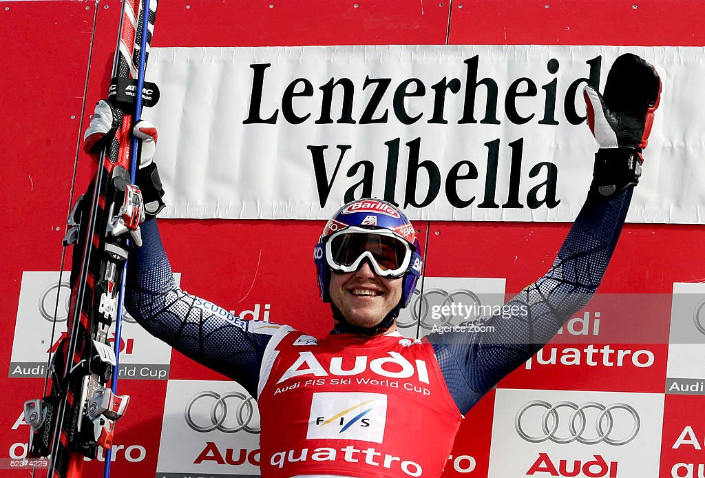 Bode Miller of the USA celebrates on the podium after a joint first place finish during the Mens Super-G in the FIS Alpine World Cup on March 11, 2005 in Lenzerheide, Switzerland.