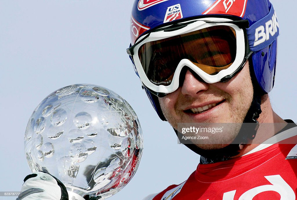 Bode Miller of the USA poses with the Super-G Crystal Globe after a joint first place finish during the Mens Super-G in the FIS Alpine World Cup on March 11, 2005 in Lenzerheide, Switzerland.