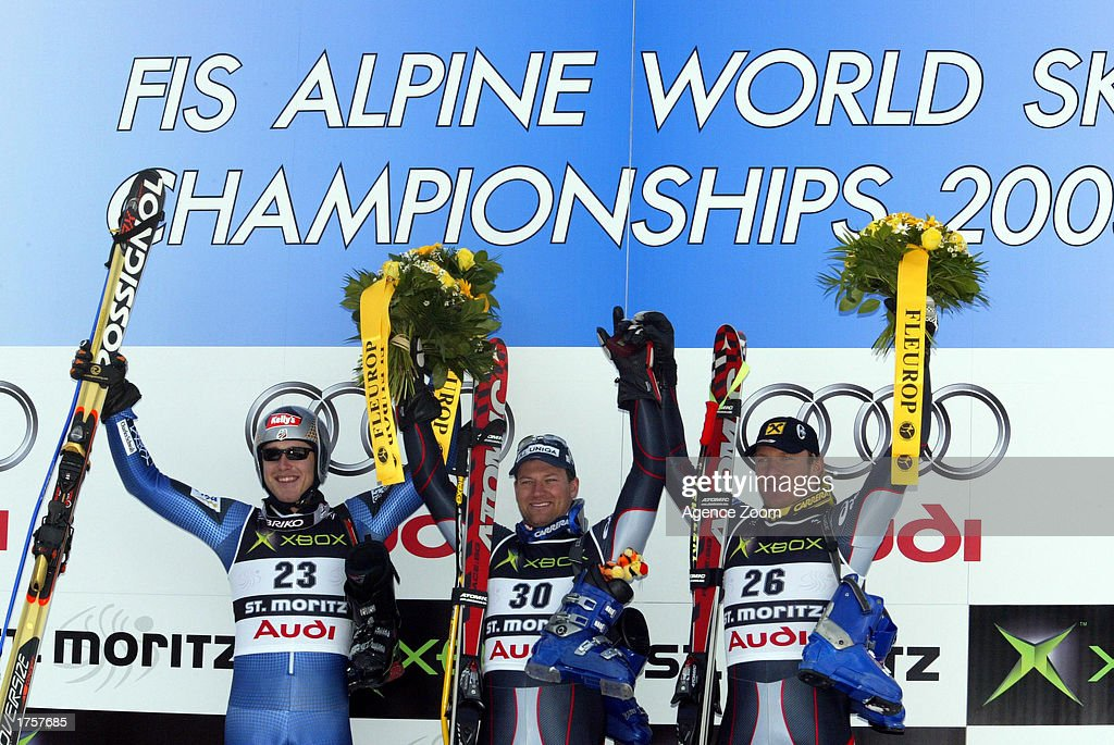 Bode Miller of the USA, Stephan Heberharter of Austria, and Hermann Maier of Austria stand on the winners podium for the Men's Super G at the 2003 FIS World Cup Ski Championship on February 2, 2003, in Saint Moritz, Switzerland.