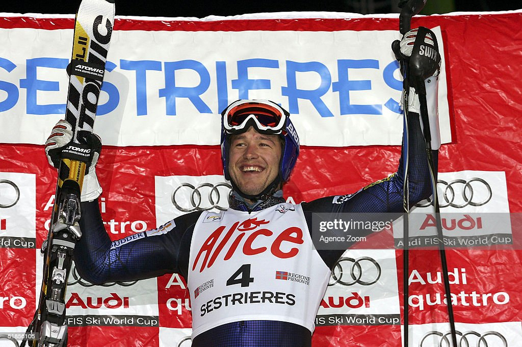 Bode Miller of USA celebrates his victory on the podium during the FIS Alpine Ski World Cup Men's Slalom Event at Sestriere Sporting Club on December 13, 2004 in Sestriere, Italy.