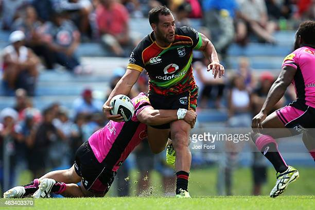 Bodene Thompson of the New Zealand Warriors looks to offload in the tackle during the NRL Trial match between the New Zealand Warriors and the...