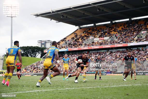 Bodene Thompson of the Warriors charges to the line to score a try during the round six NRL match between the New Zealand Warriors and the Parramatta...