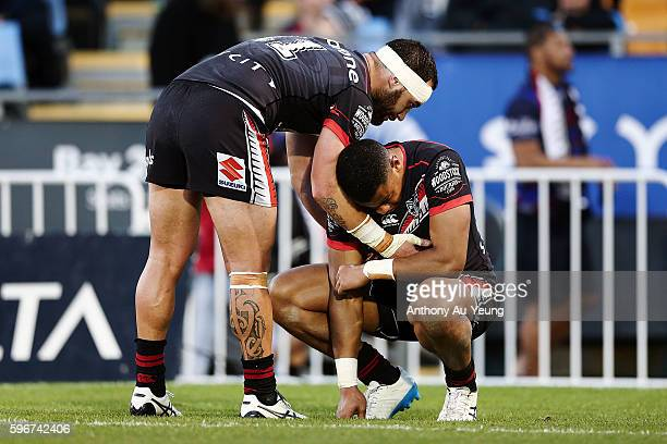 Bodene Thompson of the Warriors comforts teammate David Fusitu'a after losing the round 25 NRL match between the New Zealand Warriors and the Wests...