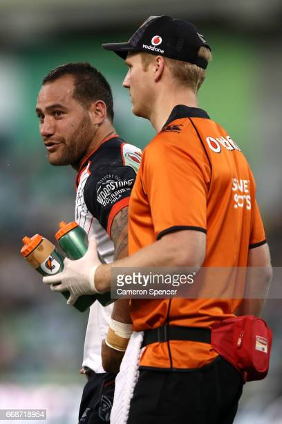 Bodene Thompson of the Warriors is assisted off the field during the round seven NRL match between the Canberra Raiders and the New Zealand Warriors...