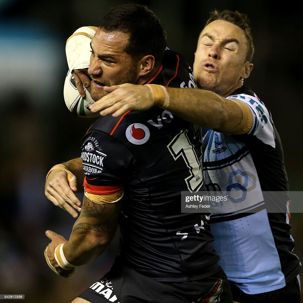 Bodene Thompson of the Warriors is tackled by <a gi-track='captionPersonalityLinkClicked' href=/galleries/search?phrase=James+Maloney&family=editorial&specificpeople=2672556 ng-click='$event.stopPropagation()'>James Maloney</a> of the Sharks during the round 16 NRL match between the Cronulla Sharks and the New Zealand Warriors at Southern Cross Group Stadium on June 25, 2016 in Sydney, Australia.