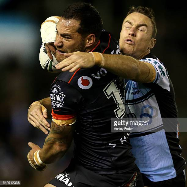 Bodene Thompson of the Warriors is tackled by James Maloney of the Sharks during the round 16 NRL match between the Cronulla Sharks and the New...