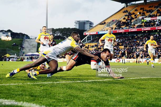Bodene Thompson of the Warriors scores a try against Edrick Lee of the Raiders during the round 16 NRL match between the New Zealand Warriors and the...