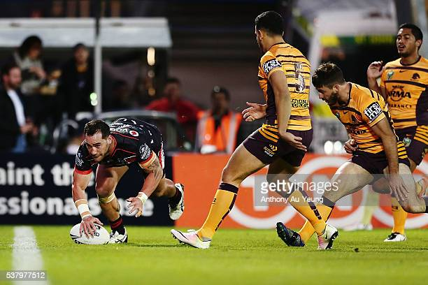 Bodene Thompson of the Warriors scores a try during the round 13 NRL match between the New Zealand Warriors and the Brisbane Broncos at Mt Smart...