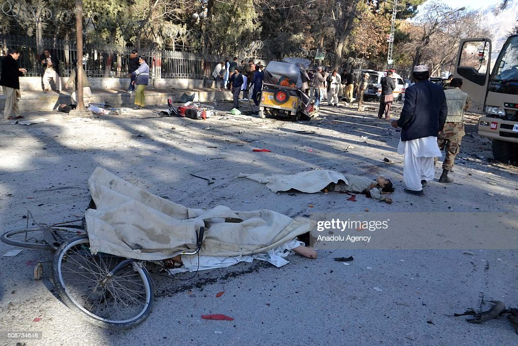 Bodies are seen at the site of a suicide attack in Quetta, Pakistan, on February 6, 2016. At least nince people were killed and several others wounded in the suicide attack near the premises of the heavily guarded Quetta district courts on Saturday.