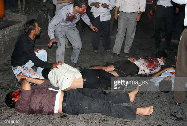 Bodies are strewn outside the Jameh mosque in the southeastern Iranian city of Zahedan on July 15 2010 Two suicide bombings at a Shiite mosque in...