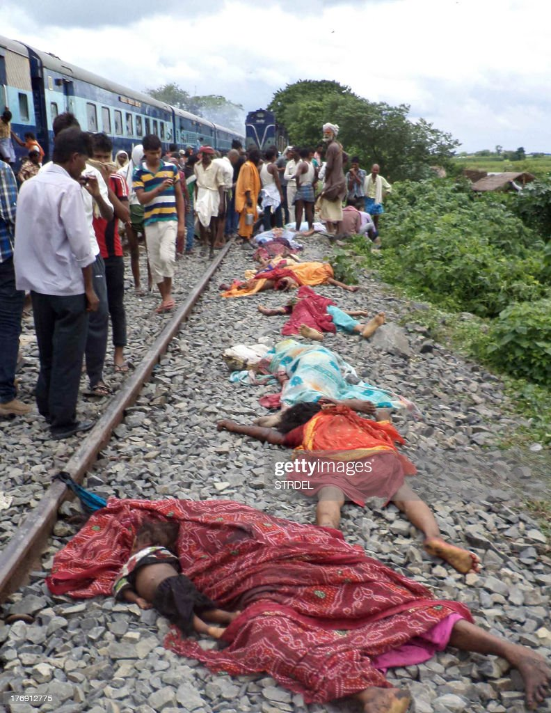 Bodies lie along the railroad tracks after a train ploughed into a crowd of Hindu pilgrims at the Dhamara Ghat railway station in Khagaria district, some 248 kilometres (154 miles) from Bihar state capital Patna, on August 19, 2013. An Indian express train ploughed into a crowd of Hindu pilgrims in the country's east on August 19, killing 37 and triggering a riot that left one of the drivers dead, an official said.