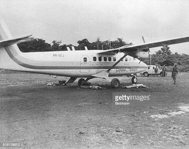Bodies lie on the Port Kaituma airstrip by the plane which was to carry them back to Georgetown Congressman Leo Ryan and four other Americans were...