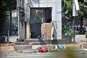 Bodies lie on the street next to a damaged police post after a series of blasts hit the Indonesia capital Jakarta on January 14 2016 A series of...