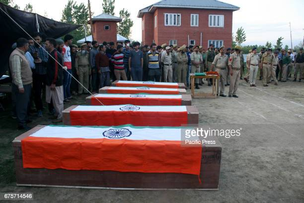 Bodies of five slain cops draped in Indian tricolor flag for wreath Laying ceremony at Kulgam Seven persons including five policemen and two bank...