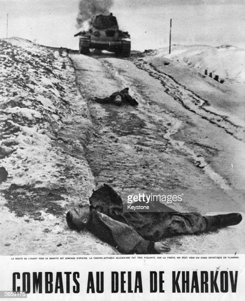Bodies of German soldiers in the snow at Kharkov in the Ukraine A stricken Russian tank is in the background