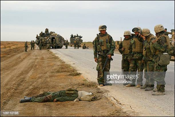 Bodies Of Iraqi Soldiers On The Road To Baghdad After An Apache Helicopter Attack On April 2 2003 In Iraq Us Soldiers Come And Take A Close Look At...