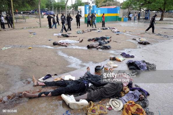Bodies of Islamic fundamentalists shot this morning during crossfire with policemen lie on a deserted road in Maiduguri on July 28 2009 Fighting...