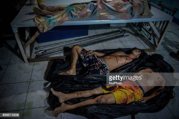 Bodies of men killed in antiillegal drugs operations lie inside a morgue in Malabon Metro Manila Philippines August 17 2017 Amidst the drug...