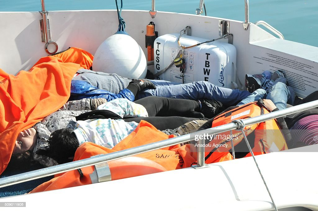 Bodies of refugees are seen after a refugee boat sank in the Aegean sea at Edremit bay in Balikesir, Turkey on February 8, 2016. 22 refugees lost their lives, only 4 of them were rescued.