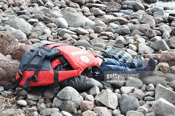 Bodies of refugees are seen on a beach after a boat carrying refugees sank off close to coast of Ayvacik district Canakkale Turkey on January 30 2016...