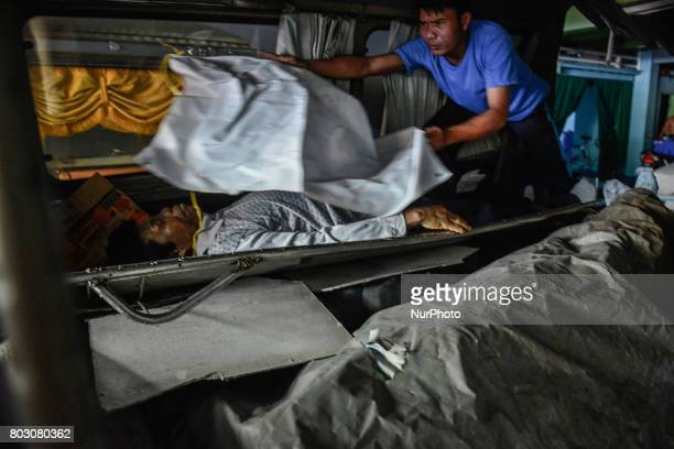 Bodies of shooting victims unclaimed for months are loaded into a van before they are to be buried in a mass grave in Navotas north of Manila...