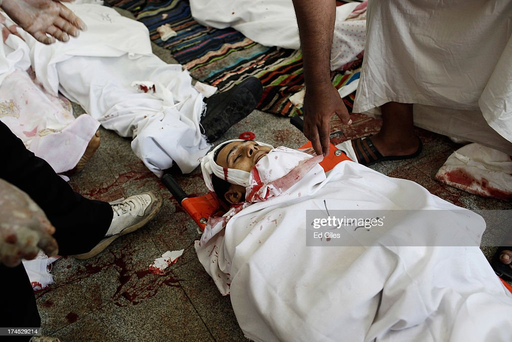 Bodies of supporters of deposed Egyptian President Mohammed Morsi lie on the floor of a field hospital after reportedly being killed in fighting...