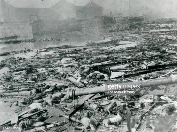Bodies of the Great Kanto Earthquake victims and debris float in Sumida River in September 1923 in Tokyo Japan The estimated Magnitude 79 strong...