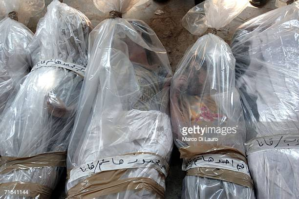 Bodies of the victims of the Israeli air strike in Qana are seen at the morgue wrapped in plastic after being brought from Qana July 30 2006 in Tyre...