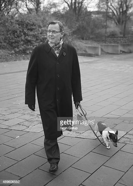 Bodo Ramelow head of the Die Linke party faction in the Thuringia state parliament walks with his dog Attila on November 26 2014 in Erfurt Germany...