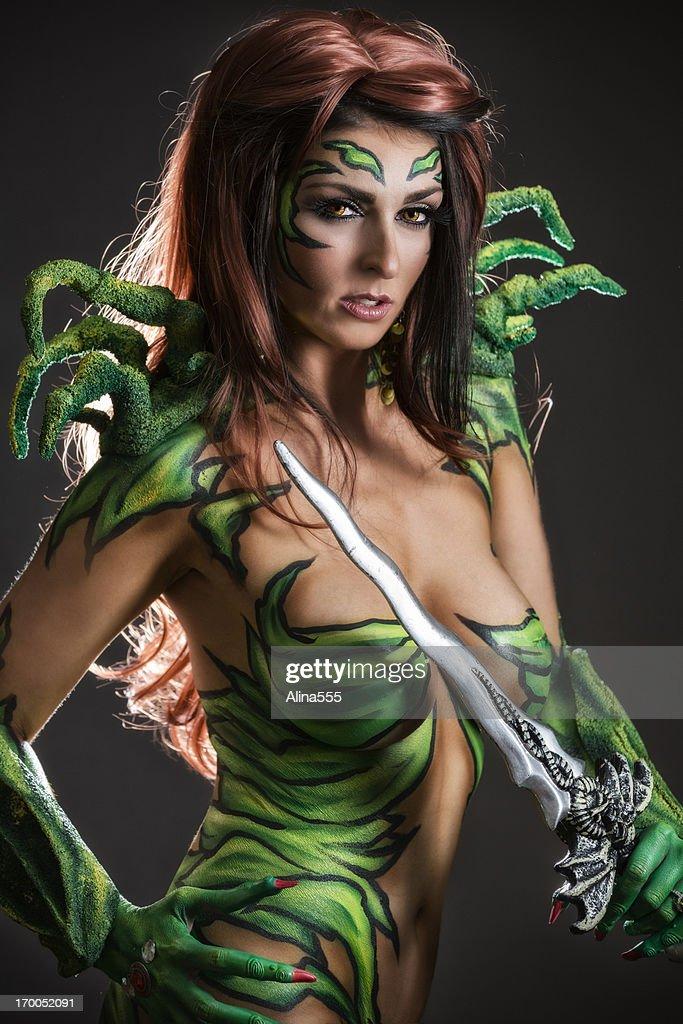 Body art: Alien goddess with sword : Stockfoto