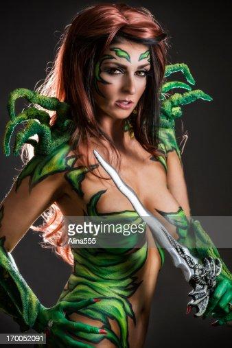 Body art: Alien goddess with sword : Stock Photo