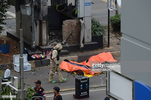 Body bags cover victims outside a traffic police outpost after a series of explosions hit central Jakarta on January 14 2016 Gunfire and explosions...